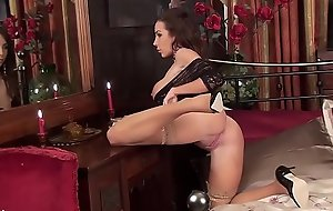 Beautiful brunette Milf Nina Leigh arrives to entertain you in the brush tan nylons