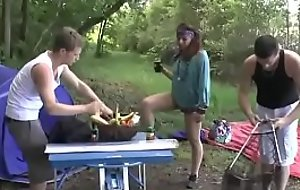 A girl fucked hard by two guys in all directions a camping