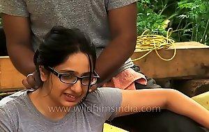 Woman receives sanative massage in Indian Himalaya.MP4