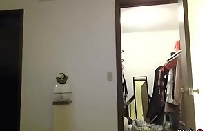 A catholic shows her clothes front the webcam