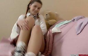 Schoolgirl masturbates with dildo