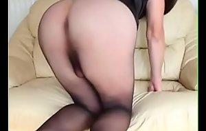 Sexy crossdresser teasing in stockings