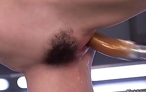 Hairy snatch brunette fucks device