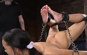 Ebony slave in back bend bondage