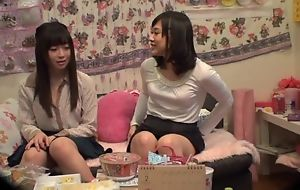 Adorable Asian lady pleasuring her lesbian friend