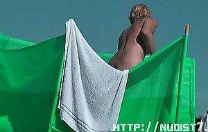 Clumsy public nudist beach voyeur vid